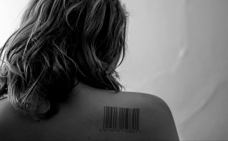Woman with a barcode on her shoulder.